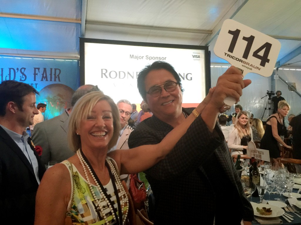 Robert and Kim Kiyosaki bid on several lots, raising hundreds of thousands of dollars for charity.